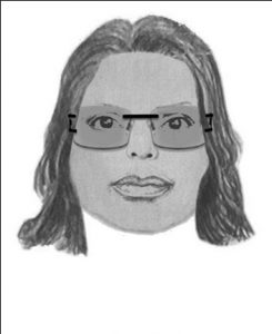 "This suspect is described as an African American female in her early 20's with a dark complexion. She is approximately 5'05"" to 5'07"" tall with a thin build. She was wearing a multicolored knit shirt, shorts, and Versace sunglasses with a black and gold logo on the sides."